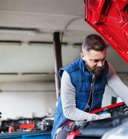 man-mechanic-repairing-a-car-in-a-garage-.jpg